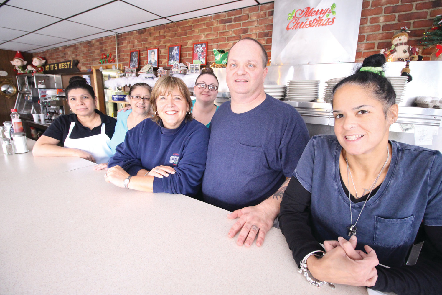 DINER TEAM: A staff of 11 keep the diner running seven days a week. Here, Kellie is joined by some of the team, including (from left) Sandra, Mary Anne, Jenny, Chuckie and Jay.