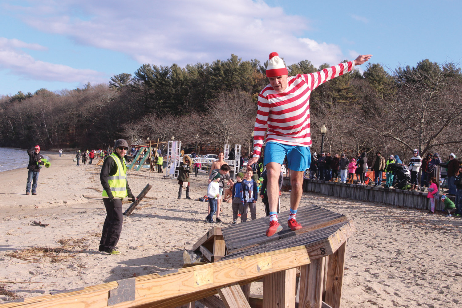 FINAL OBSTACLE: Larry Phillips, 58, from Red Hook, N.Y. runs the final challenge in the obstacle course before jumping into the bay. Phillips said he makes a point of participating in New Year's Day plunges and had this one on his list. He completed the obsta-plunge course in 16:52.LET'S