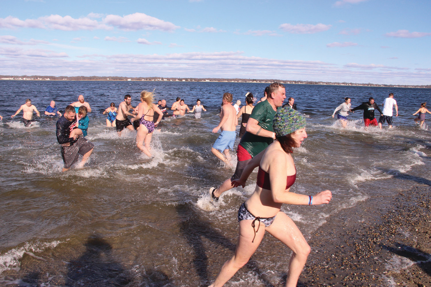 IN AND OUT: As quickly as participants raced into the water, those who preceded them ran to get out.