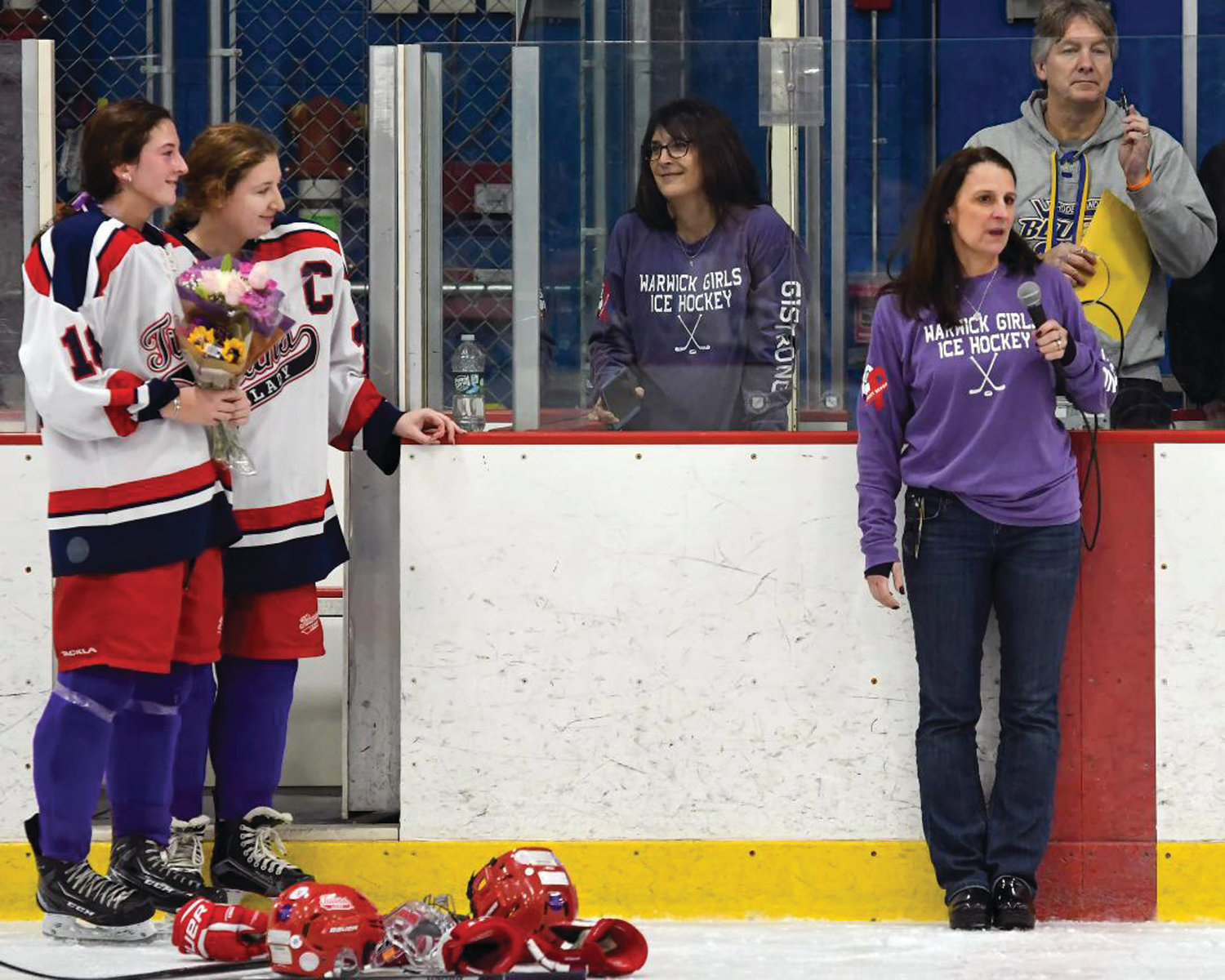 MAKING A STATEMENT: Hope Flaherty and Meaghan McCamish (left) look on as Gianna's mother, Tara, addresses the crowd.