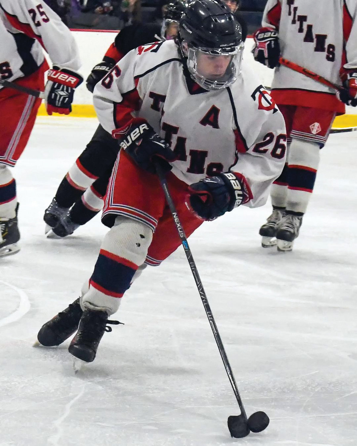 UP THE ICE: Toll Gate's Matthew Carr handles the puck.