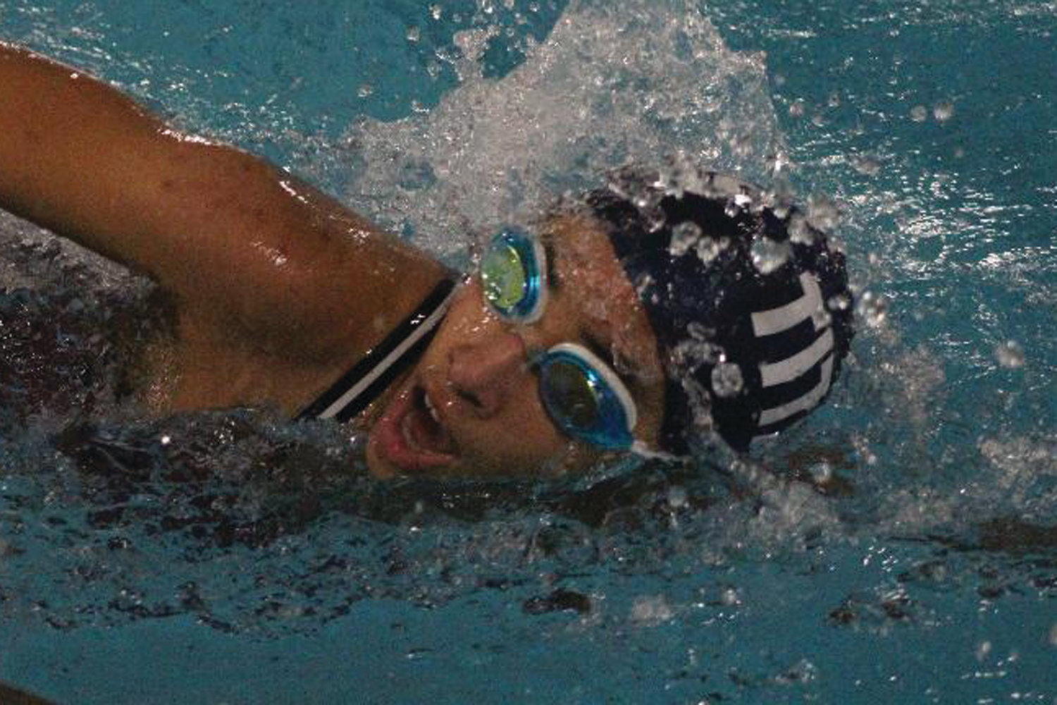 IN THE POOL: A Toll Gate swimmer competes in the 200 relay.