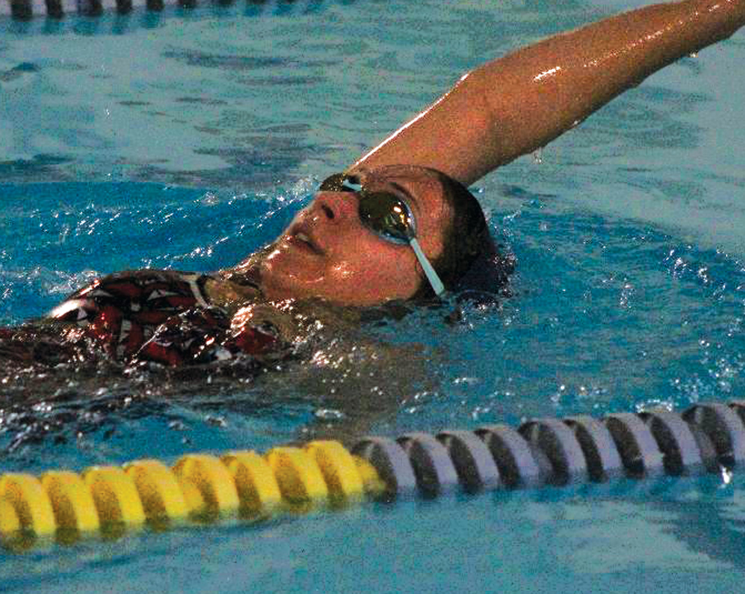 BACKSTROKE: Toll Gate's Tiffany Mai.