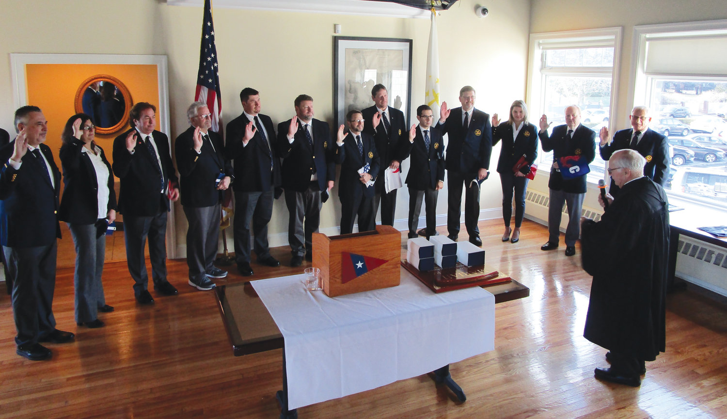 NEW SLATE: The 2020 officers and directors for the Rhode Island Yacht Club are sworn in during last week's ceremony.