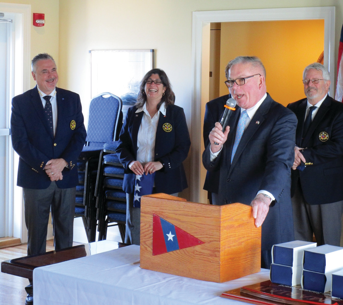 REP'S GREETINGS: Warwick state Rep. Joe McNamara speaks during the Rhode Island Yacht Club's installation ceremony on New Year's Day. Looking on are, from left, David Tessitore and Michelyn Saccoccio.
