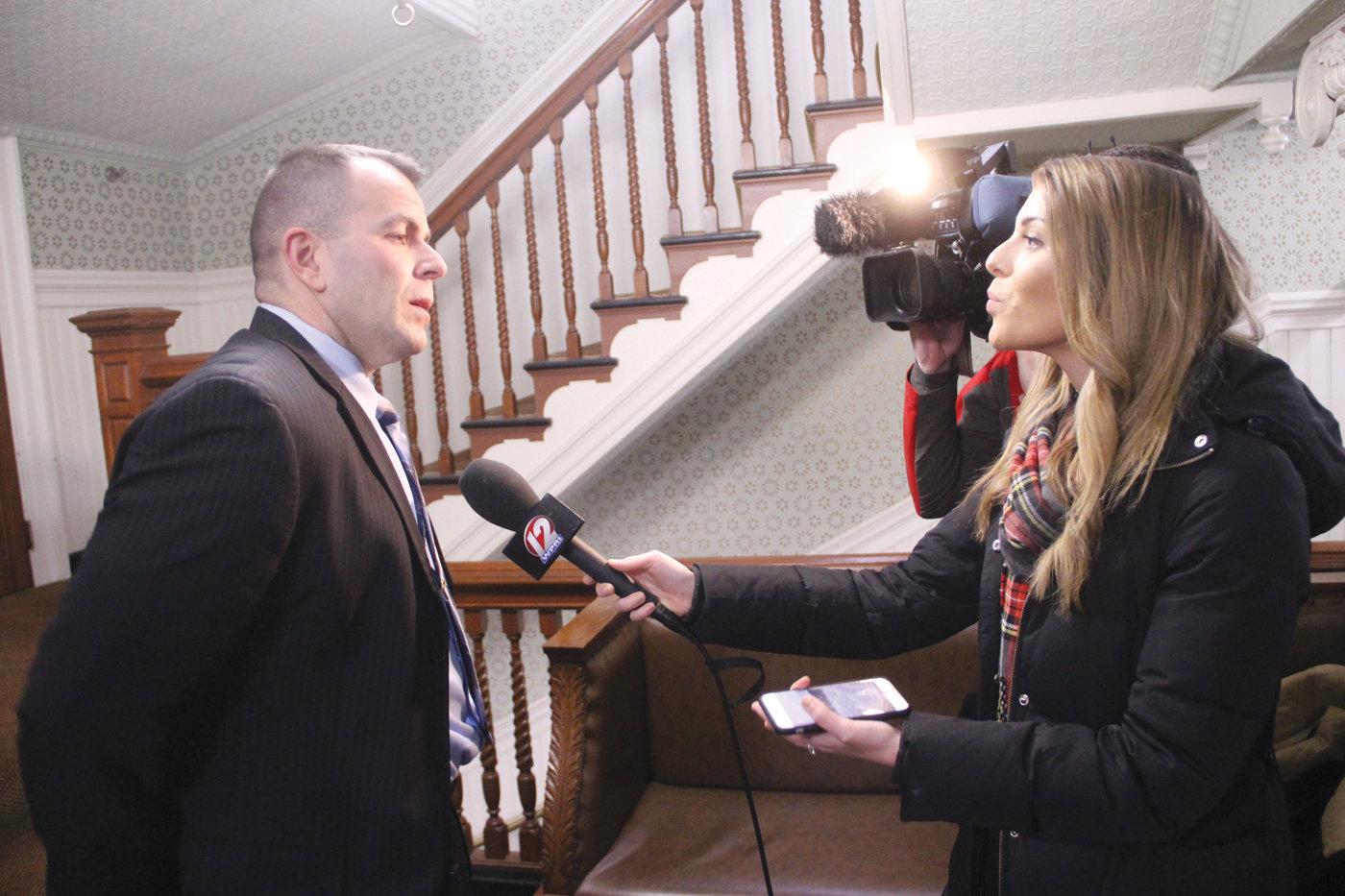 A VOTE...FINALLY: Michael Carreiro, president of the Warwick Firefighters, voices his relief that the months-long debate over a contract is over to WPRI Channel 12 reporter Carolyn Goggin following the council vote Monday.