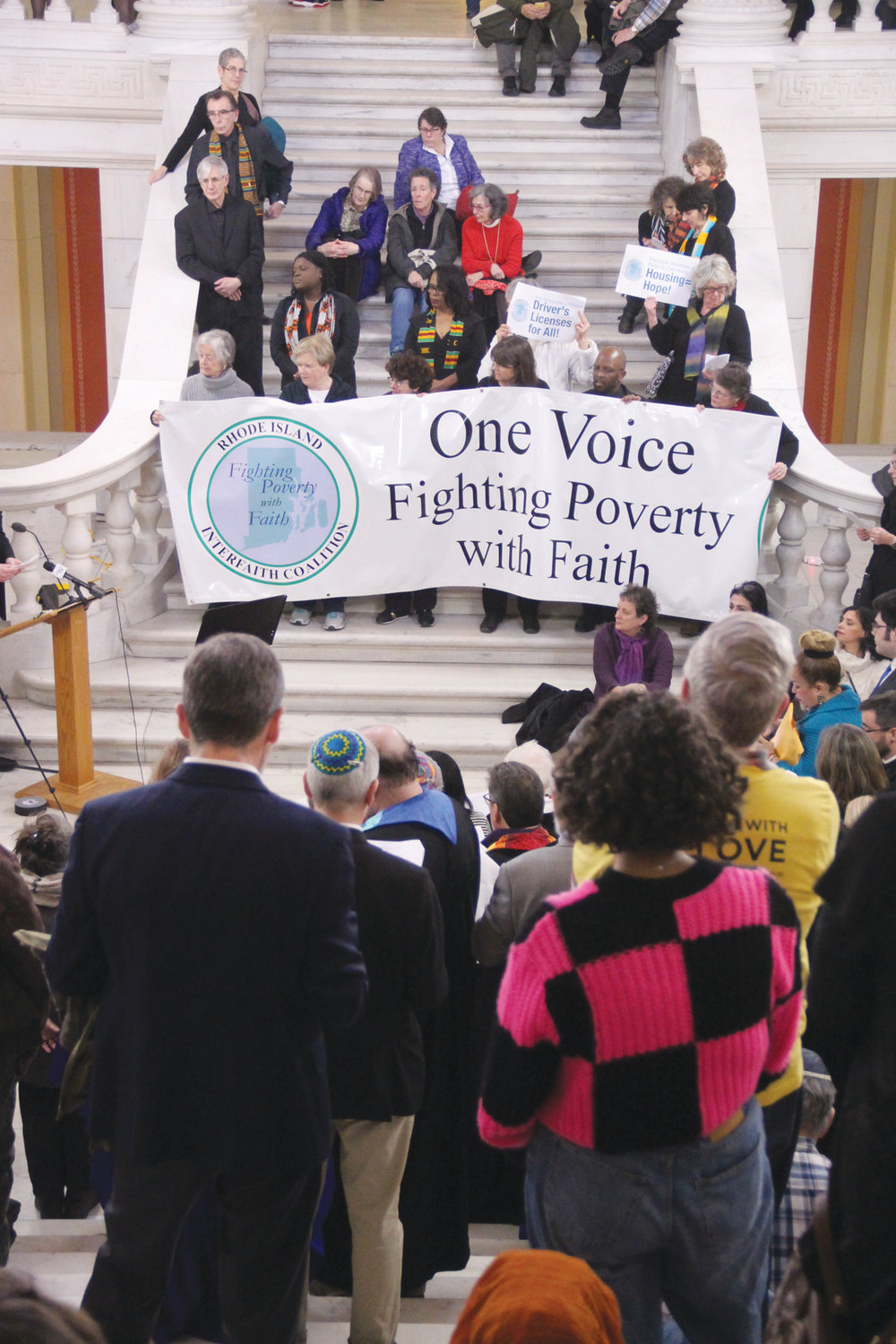 "FAITH IN THEIR LEGISLATORS: More than 200 representatives from churches across the state rallied in the State House Rotunda on the opening day of the 2020 session at a ""Fighting Poverty with Faith Vigil."" The group named legislators, praying for them. The Rhode Island Interfaith Coalition seeks to ban housing discrimination, provide more funding for affordable housing, increase staffing at nursing homes and increase the minimum wage to $15 an hour."