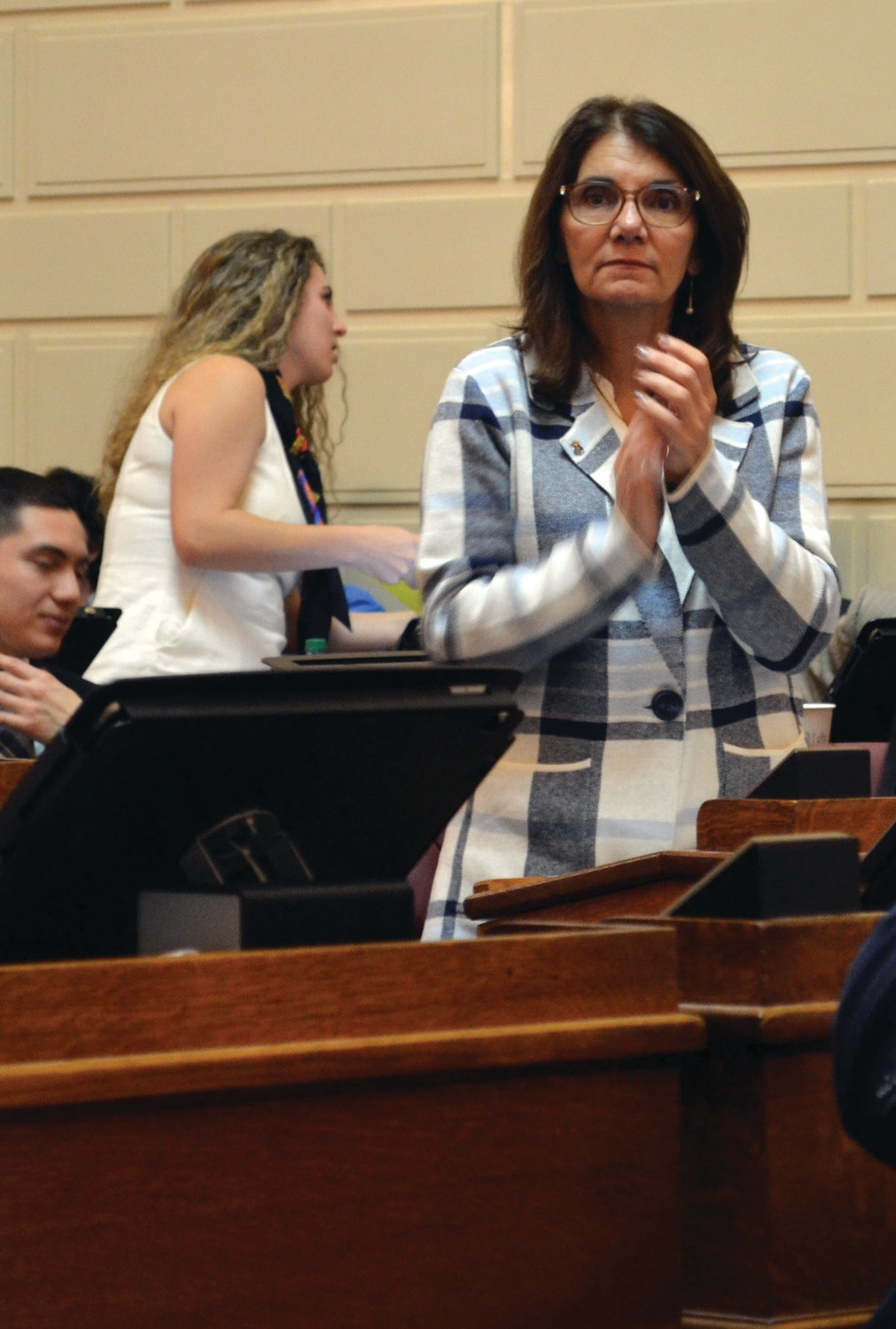 READY TO GO: Johnston Dist. 43 Rep. Deborah A. Fellela stands during a moment of applause at Tuesday's session.