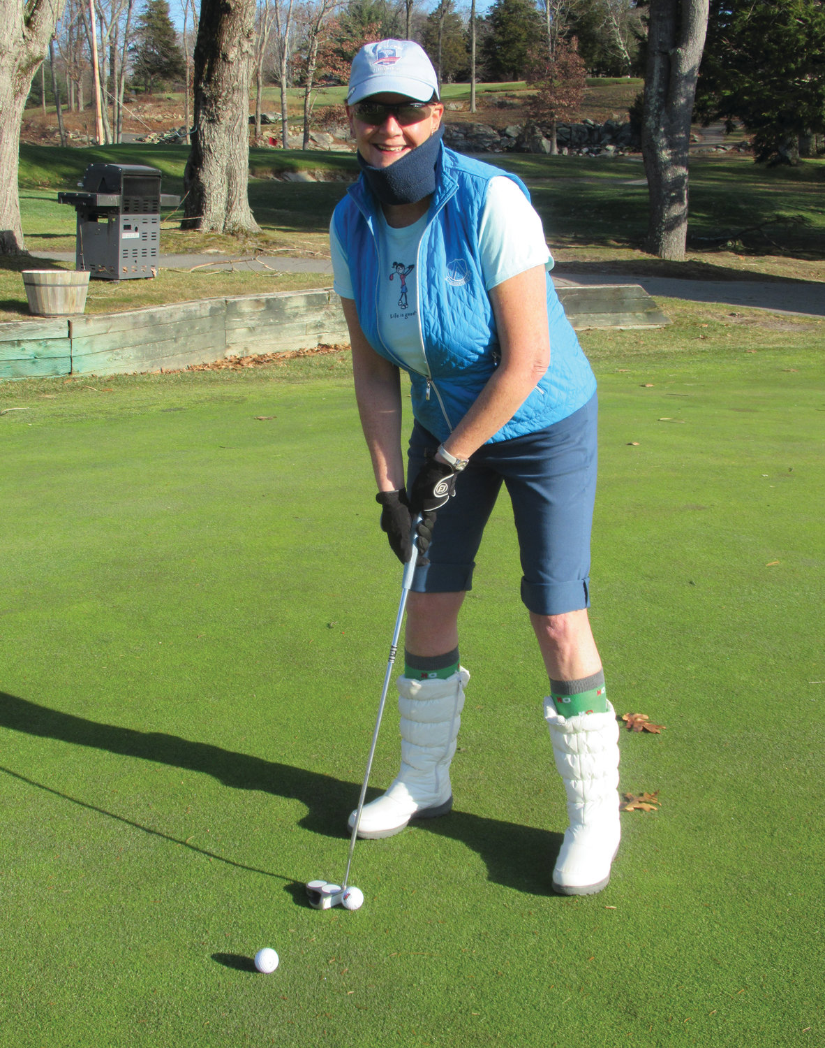 AUDREY'S ANGLE: Audrey Jorge is all smiles while warming up for the 6th Annual Polar Golf Tournament on the putting green at Glocester Country Club.