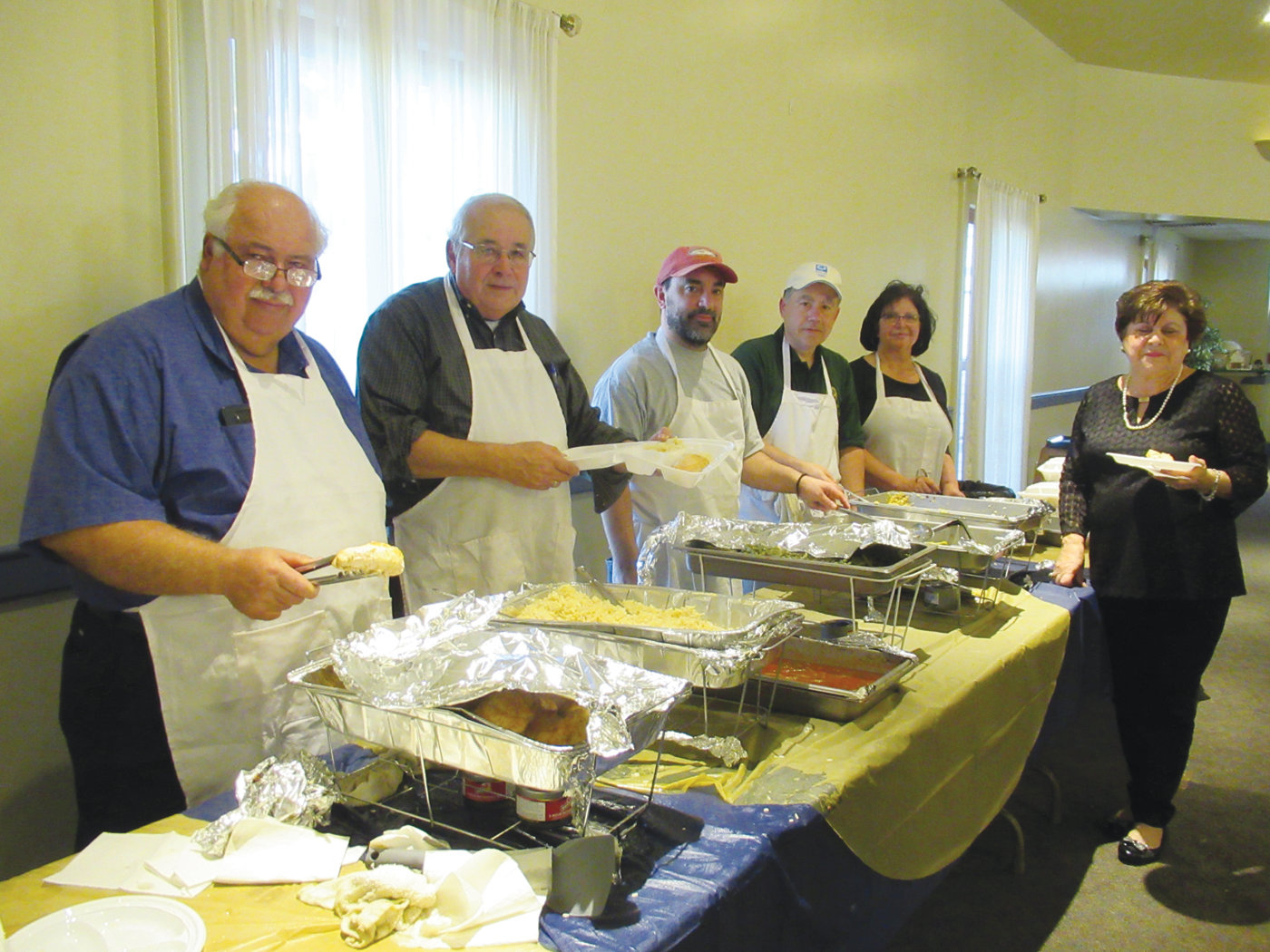SPECIAL STAFF: Among the proud parishioners at Church of the Annunciation who prepared and served Sunday's Philoptochos Vasilopeta Luncheon are, from left, Theofanis Markos, Kevin Phelan, Jimmy Grammas, Paul Kallis and Elizabeth DeGaitis.