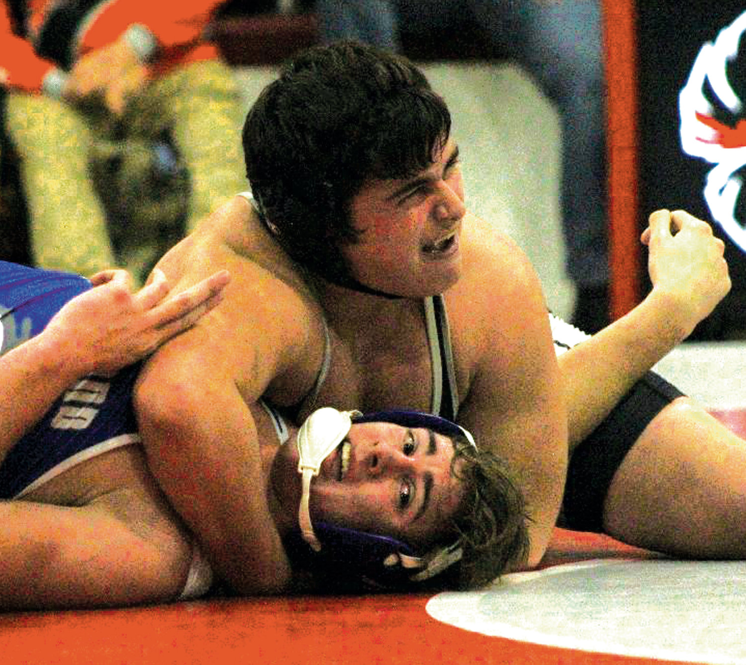 TOP POSITION: Pilgrim's Dikran Krikorian looks to secure a pin against Cumberland on Tuesday evening at Cranston West High School.