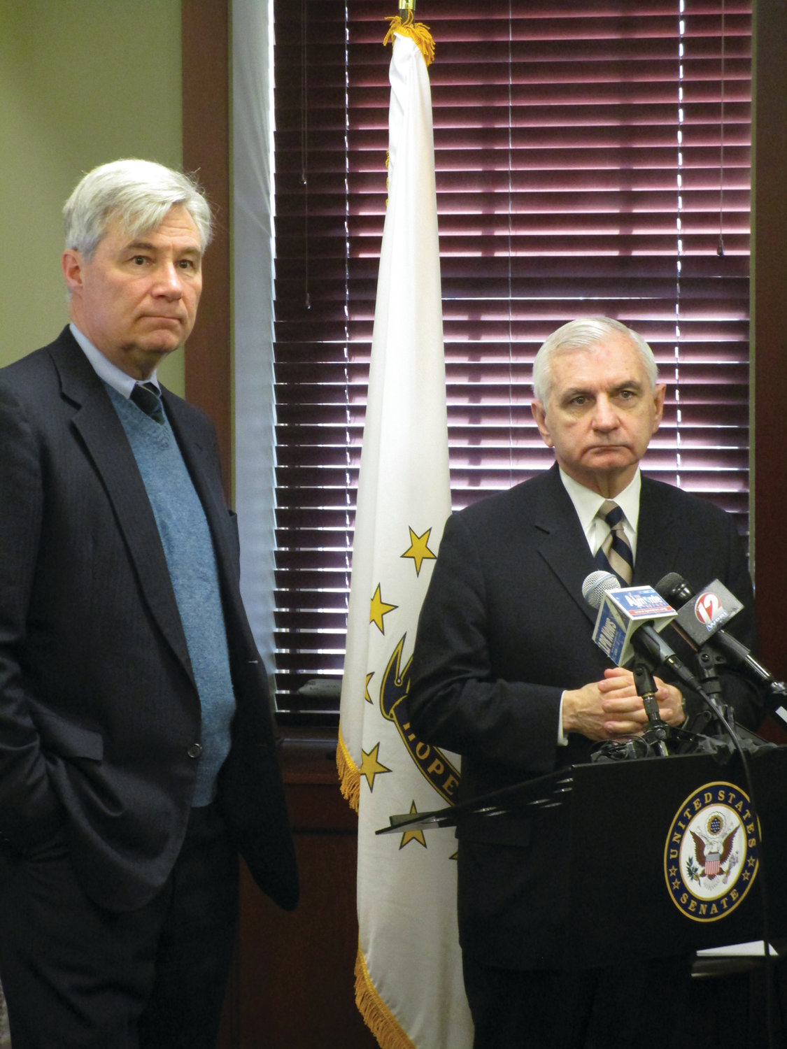PREPARING FOR THE TRIAL: U.S. Sens. Sheldon Whitehouse, left, and Jack Reed speak about the impeachment trial of President Donald Trump at Reed's office in Cranston's Chapel View on Friday.