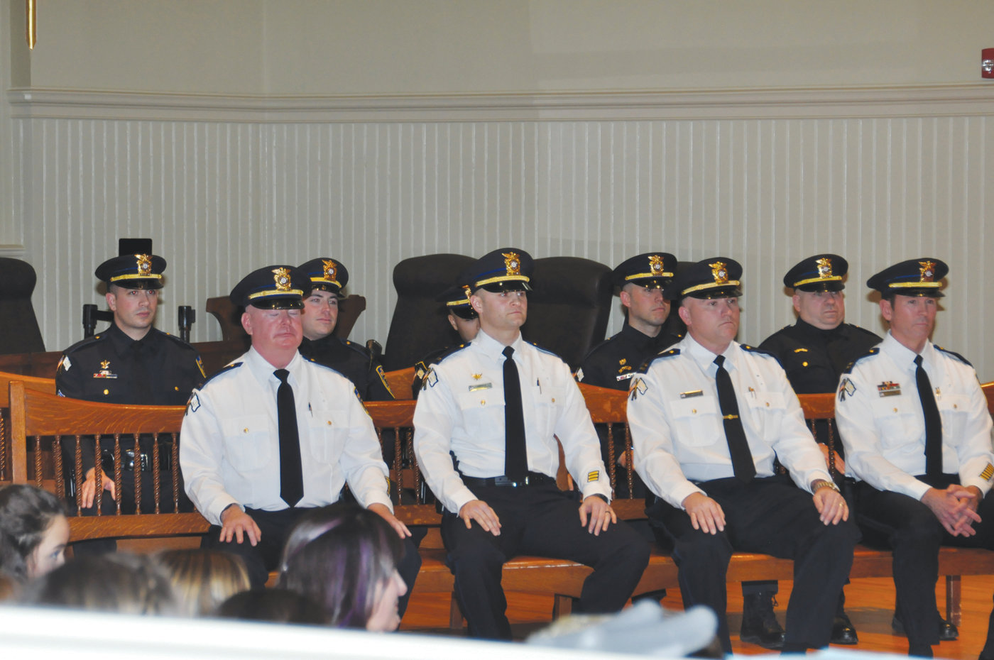 AT PROMOTION CEREMONY: During proceedings Tuesday at Warwick City Hall the follow offers were promoted (front row from right) Captain James Valkoun, Captain Scott Robillard, Lieutenant Daniel DiMaio and Lieutenant John Kelly; (back row from right) Sergeant Michael Walker, Sergeant Leo Tetreault, Sergeant Javier Cabreja, Sergeant Geoffrey Waldman and Sergeant Jason Brodeur.