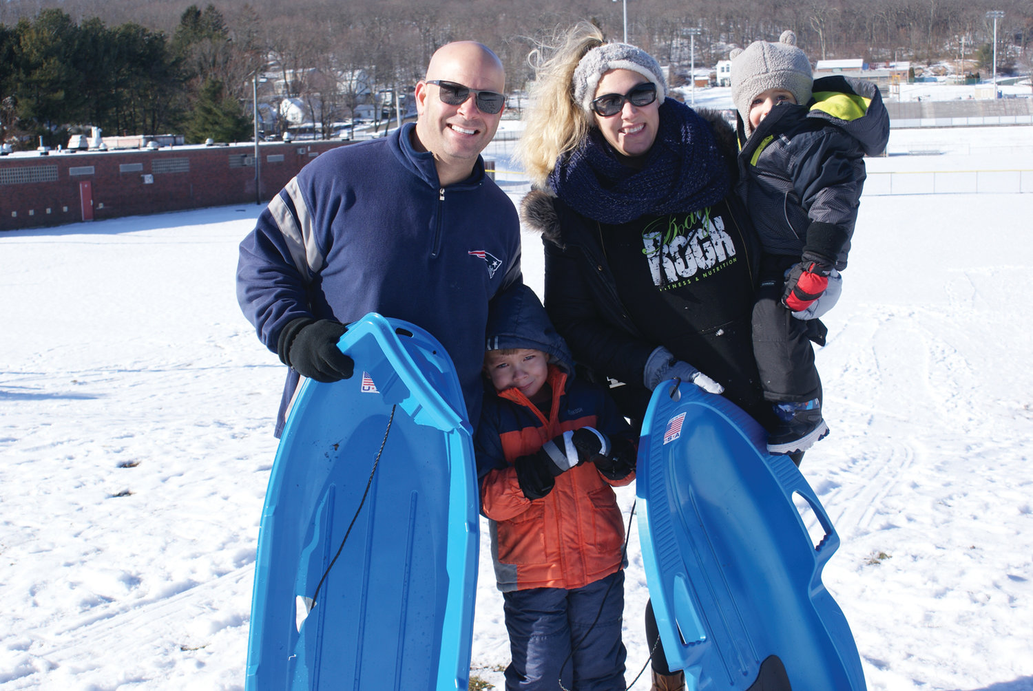 SLEDDING FAMILY: Among the Sunday morning sledders were the members of the Kyriakakis family of Cranston – Jennifer, Michael and their sons, Christian, 4, and Niko, 1.