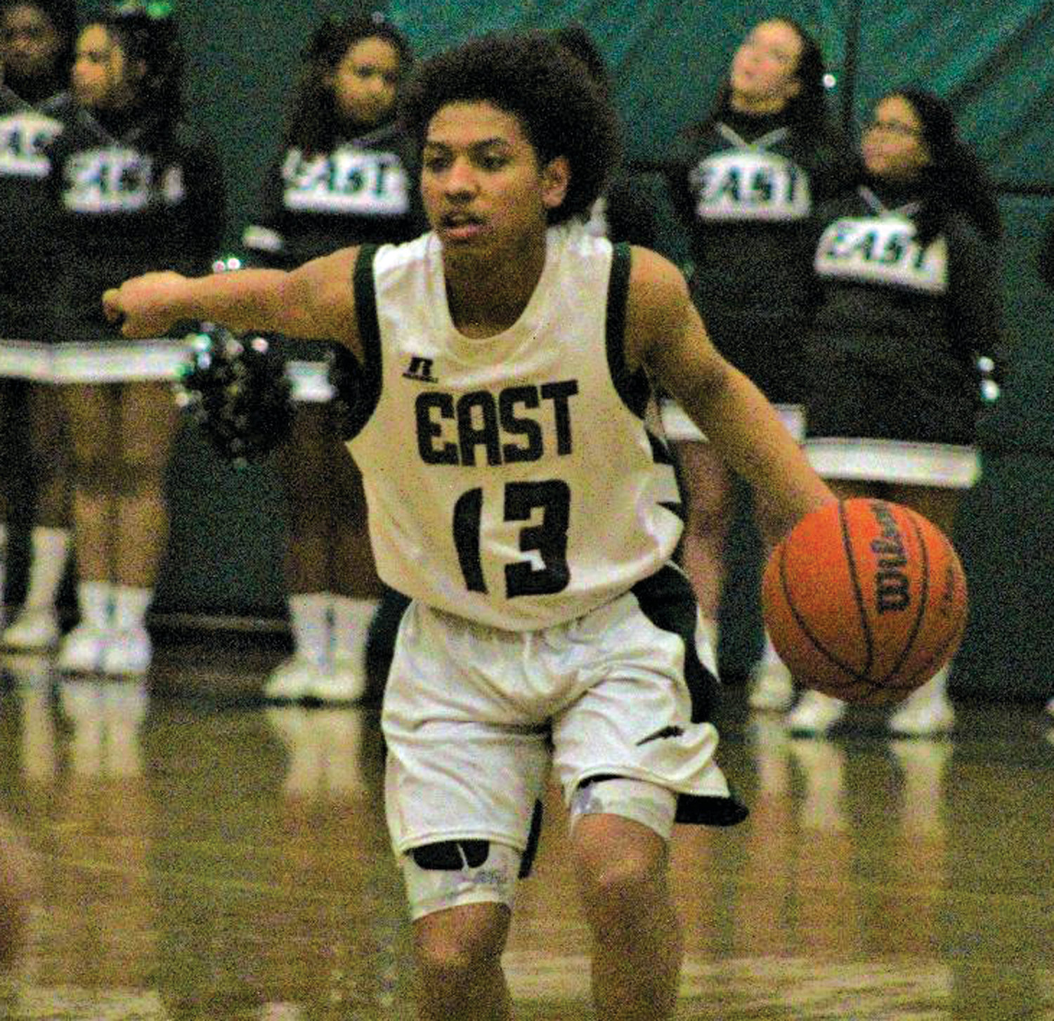 UP THE COURT: Cranston East's Brayam Murakawa brings the ball up the court.