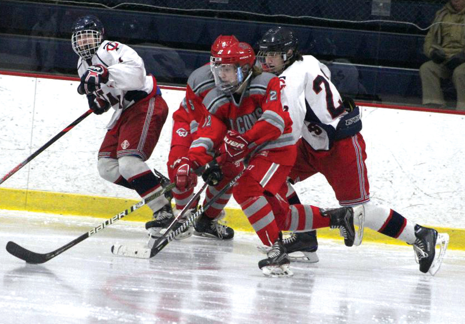 STICK WORK: Cranston West's Ryan Demers works his way up the ice against Toll Gate.