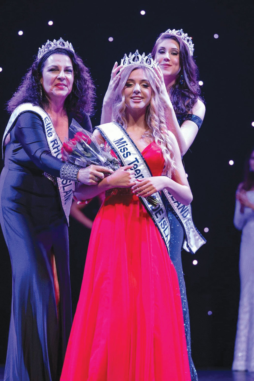 SHINING STAR: Warwick resident Sophia Skaltsis is crowned Miss Teen Rhode Island North America by Anna Casador as Gianna Paul looks on.