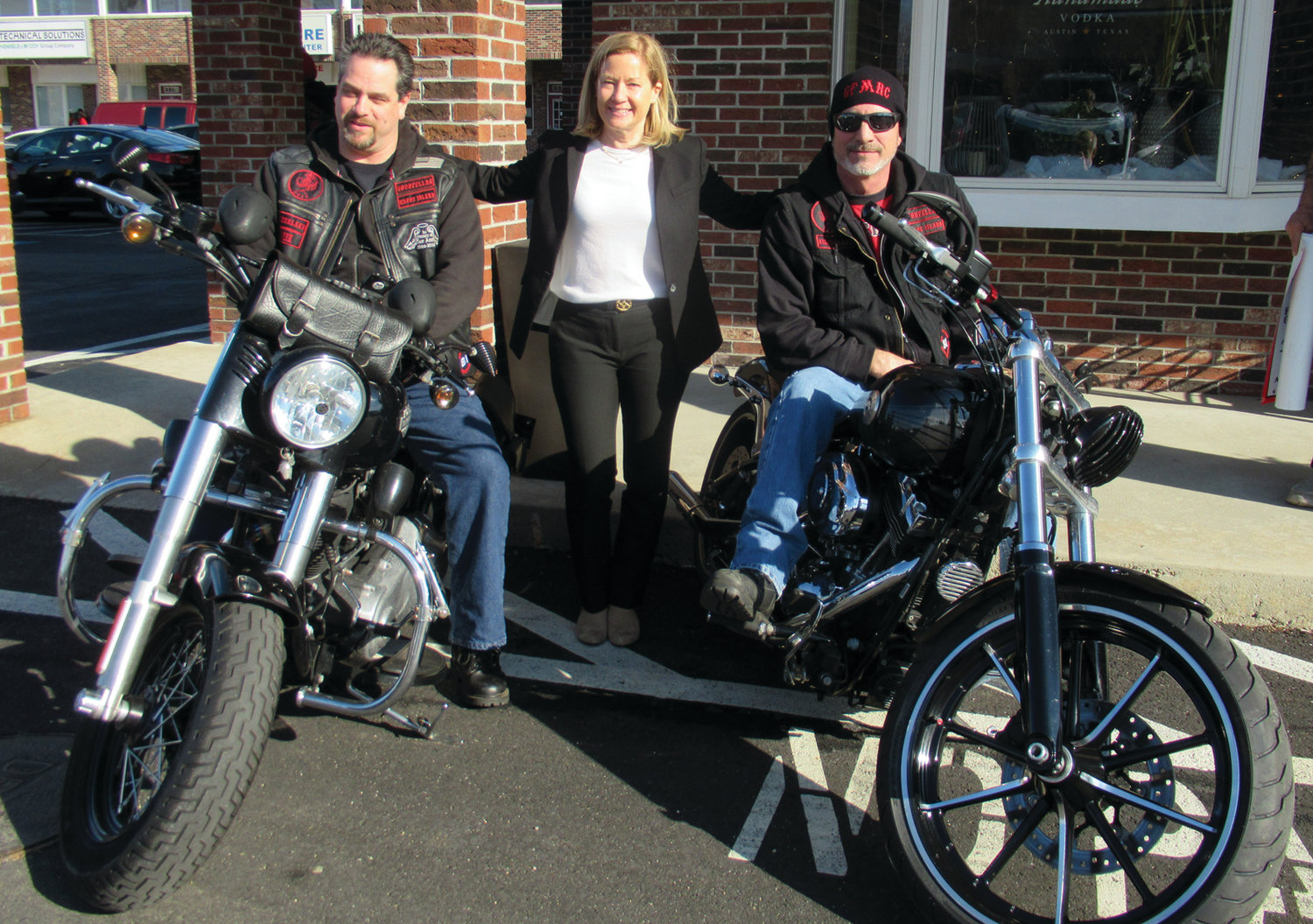 BRANNIGAN'S BIKERS: Michele Brannigan, senior major gifts officer/campaign manager at Hasbro Children's Hospital, enjoys a lighter moment with Goodfellas Motorcycle Club members Nick Demetropoulos, left, and Kevin Hart during last week's special check presentations.
