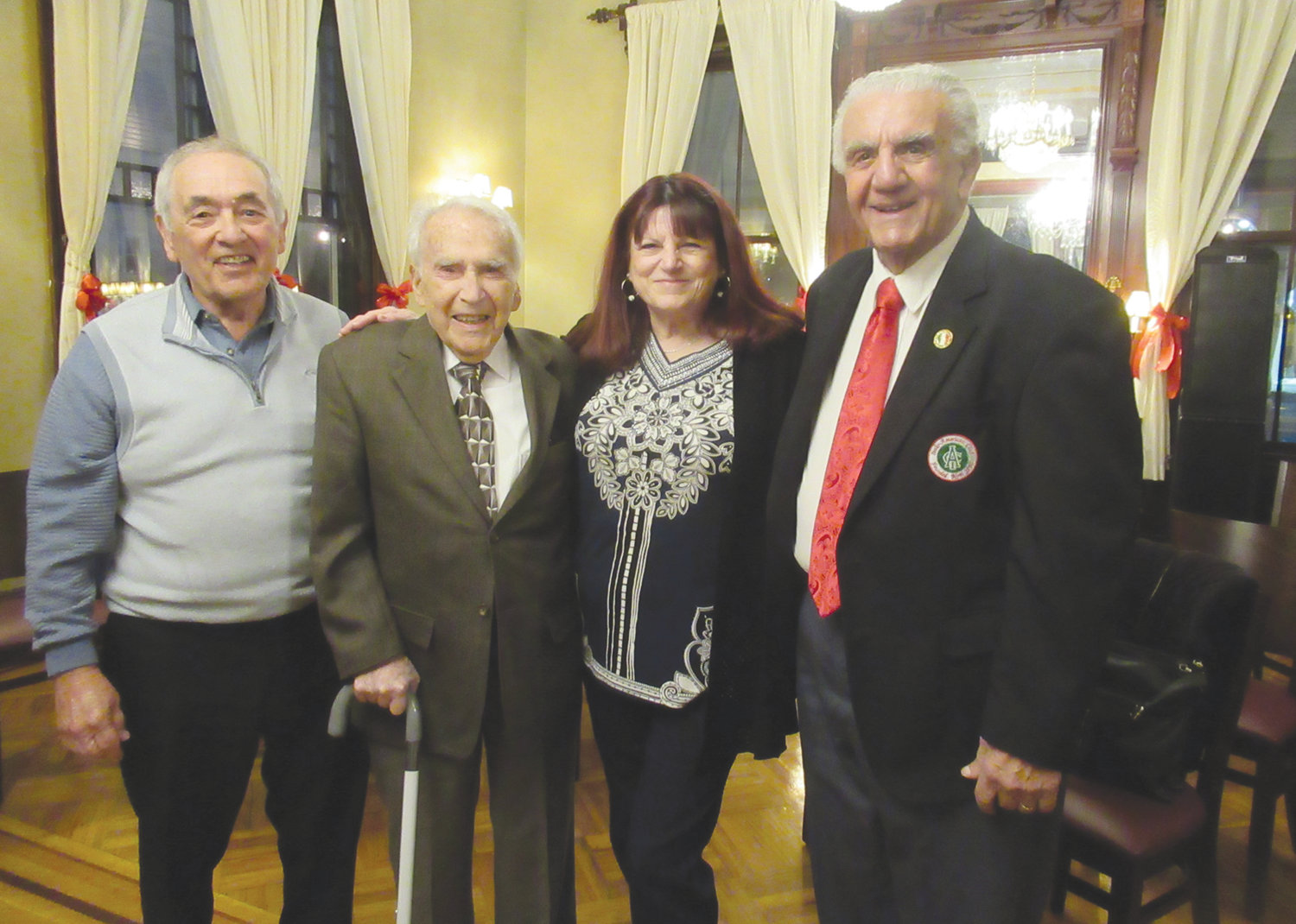 MIGHTY MEMBERS: Johnston's Julio Rotondo, second left, the oldest member of the Italo-American Club who was recently honored at a 100th birthday bash, is joined by members Joe Grasso, Linda Folcarelli and Peter Lombardi, who at age 86 stepped down from the board but was elected building superintendent by the current leadership.
