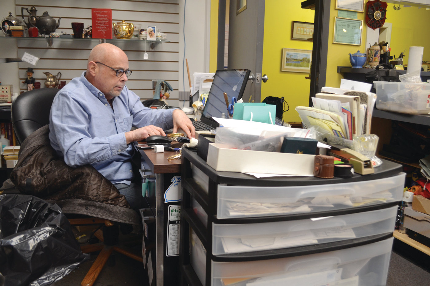 HARD AT WORK: Gold & Silver Jewelry Outlet owner Steve Melucci said the gold and silver markets are currently at a six-year high, and business is usually booming when that happens.