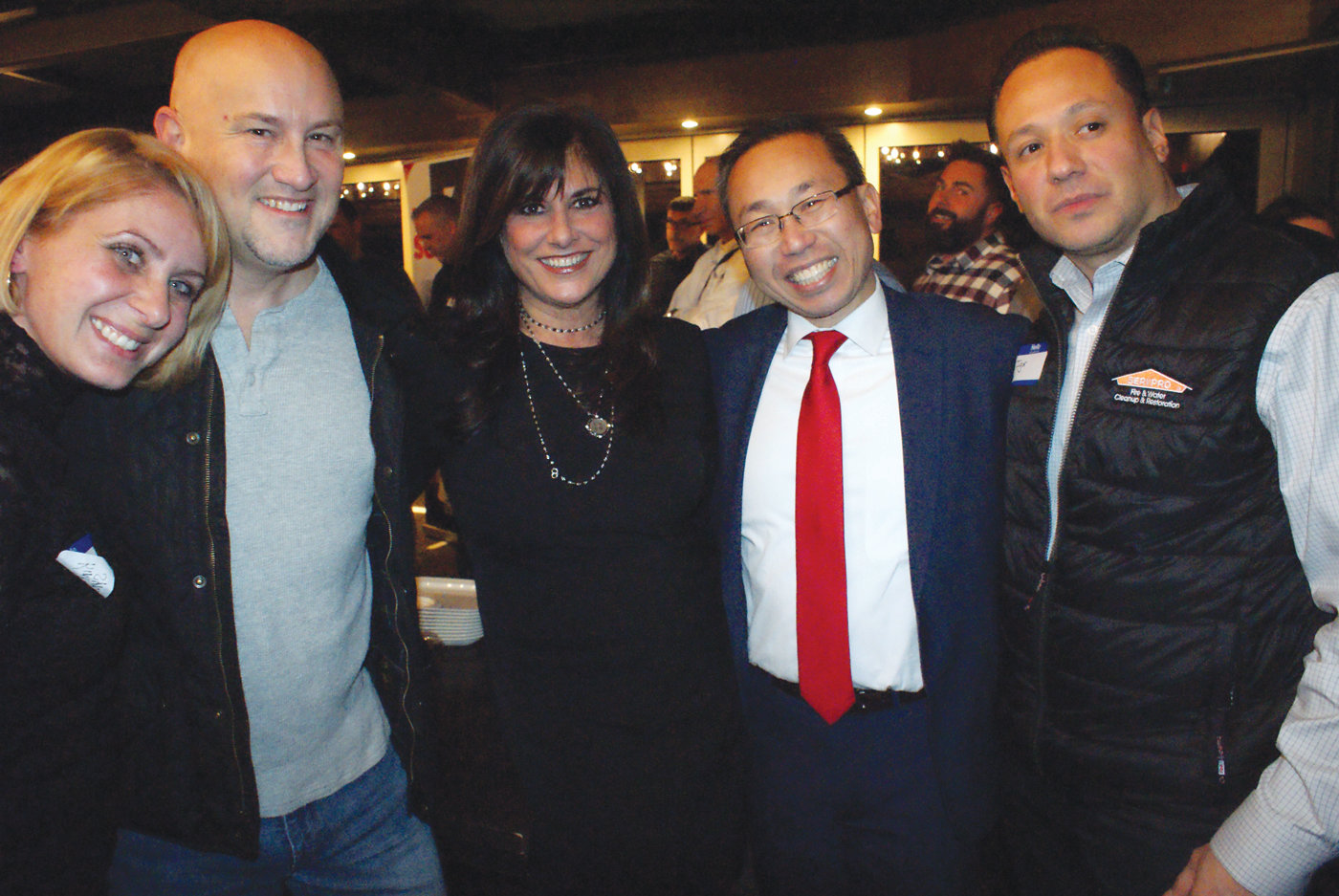 NIGHT OUT: From left, Kim Falconero, Mike Picard, Pat Paolino Cruz, Mayor Allan Fung and Igor Marroquin share a moment during the recent networking event at Chapel Grille.