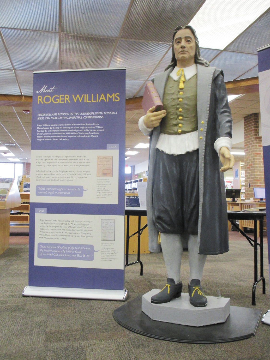 "ROVING ROGER: A 7-foot statue of Roger Williams serves as the centerpiece of the ""Roving Roger"" exhibit, which will remain at the Cranston Public Library's Central Library through February."