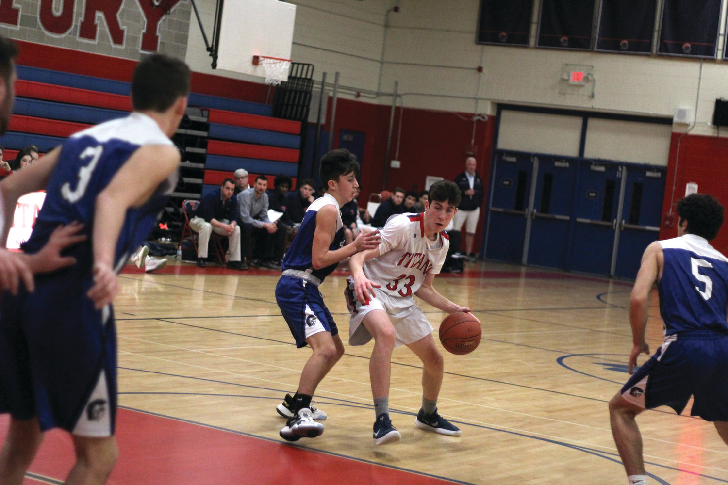 TO THE HOOP: Toll Gate's Liam Hart dribbles into the paint during the team's win over Scituate.