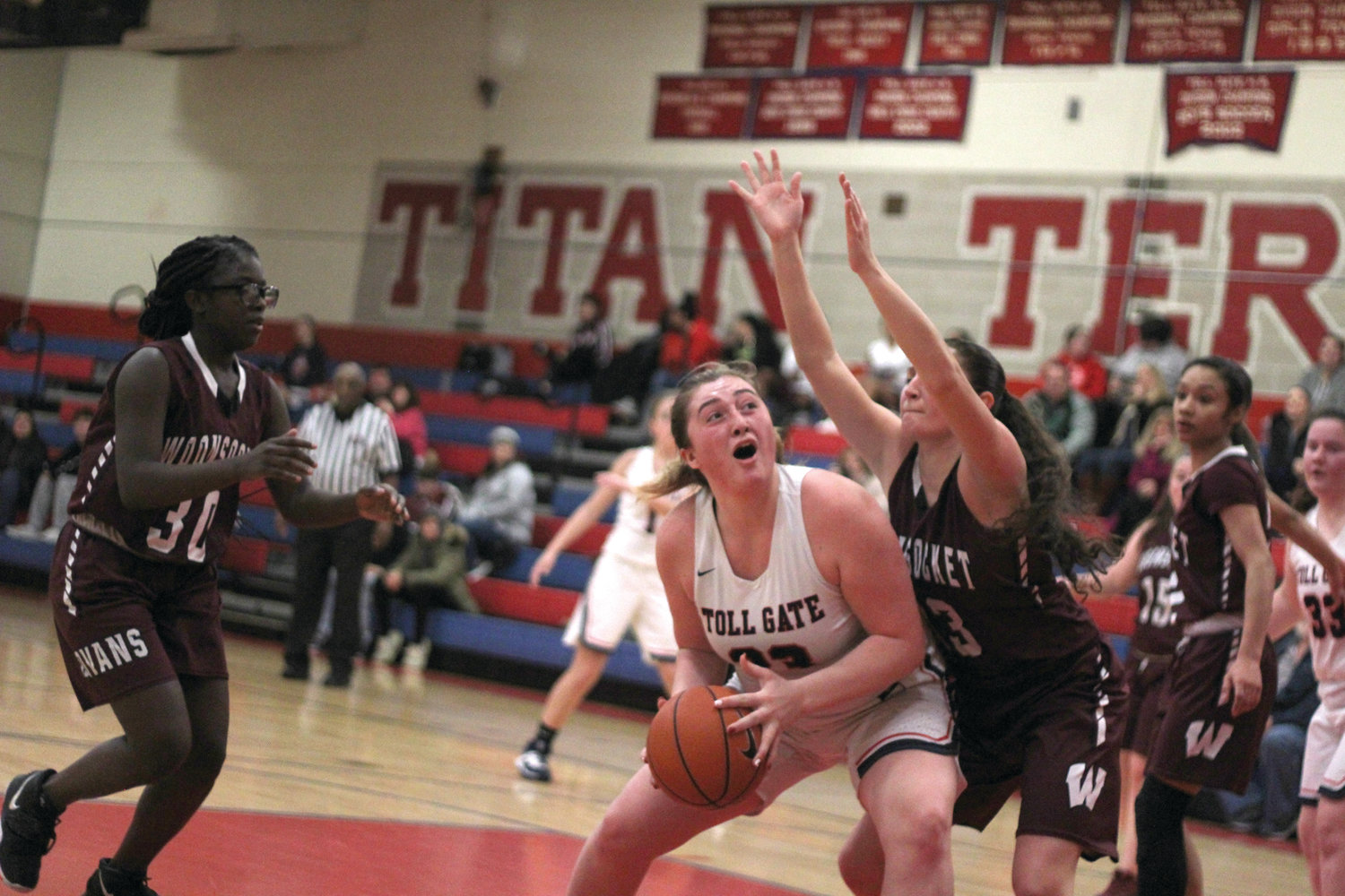 IN THE PAINT: Sam Bertrand of Toll Gate pivots to put up a shot against a Woonsocket defender during the Lady Titans' 48-22 loss on Tuesday.