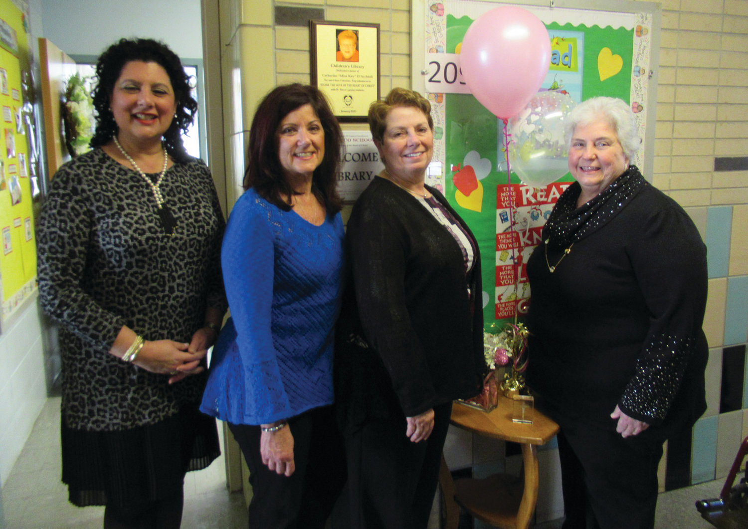 GRAND GUESTS: Lorraine S. Moschella, left, principal at St. Rocco's School, is joined by Miss Kay's nieces Alice Ballou, Catherine Parente and Betty D'Acchioli during the recent library dedication ceremony in Johnston.