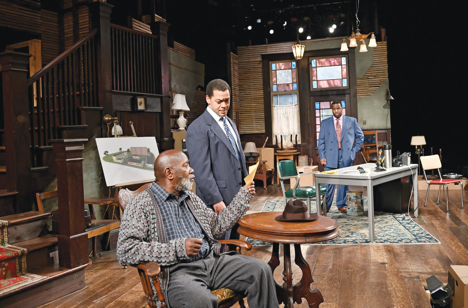Ricardo Pitts-Wiley (front) as Elder Joseph Barlow, Joe Wilson Jr. as Harmond Wilks and Omar Robinson as Roosevelt Hicks. Directed by Jude Sandy. Set design by Michael McGarty and Baron E. Pugh, costume design by Yao Chen, lighting design by Amith Chandrashaker and sound design by Larry D. Fowler Jr.