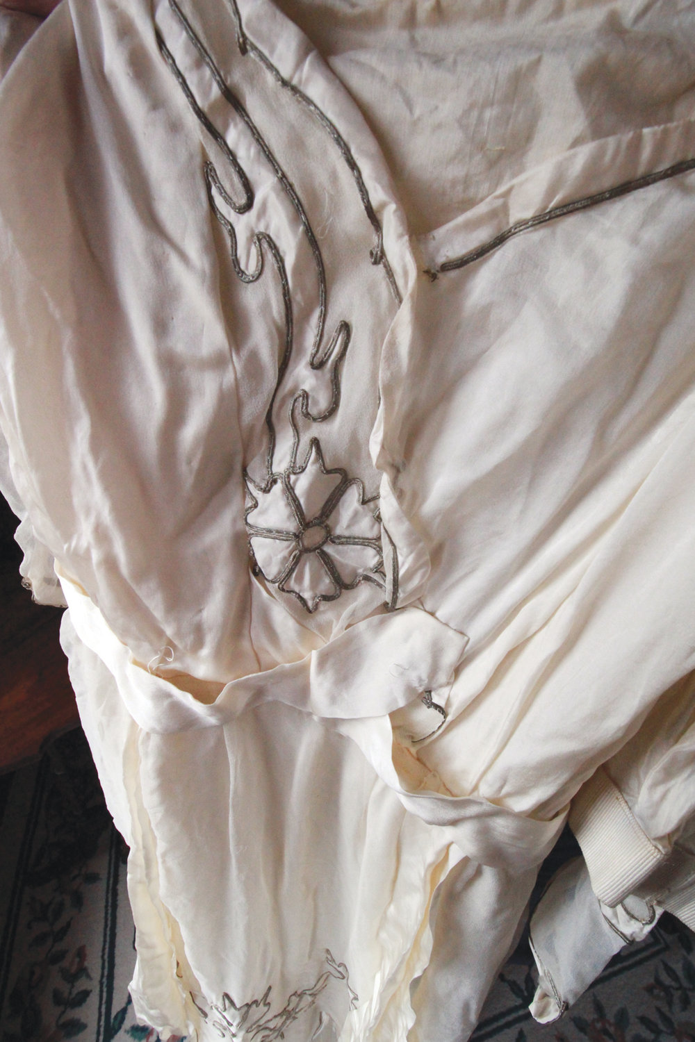 THE WORK OF SKILLED SEAMSTRESSES: Ann Holst believes this dress was the work of the Tirrochi sisters, who ran the Wedding Cake House in Providence. The sisters from Italy were sought after for their wedding dresses made from the finest French and Italian cloths.