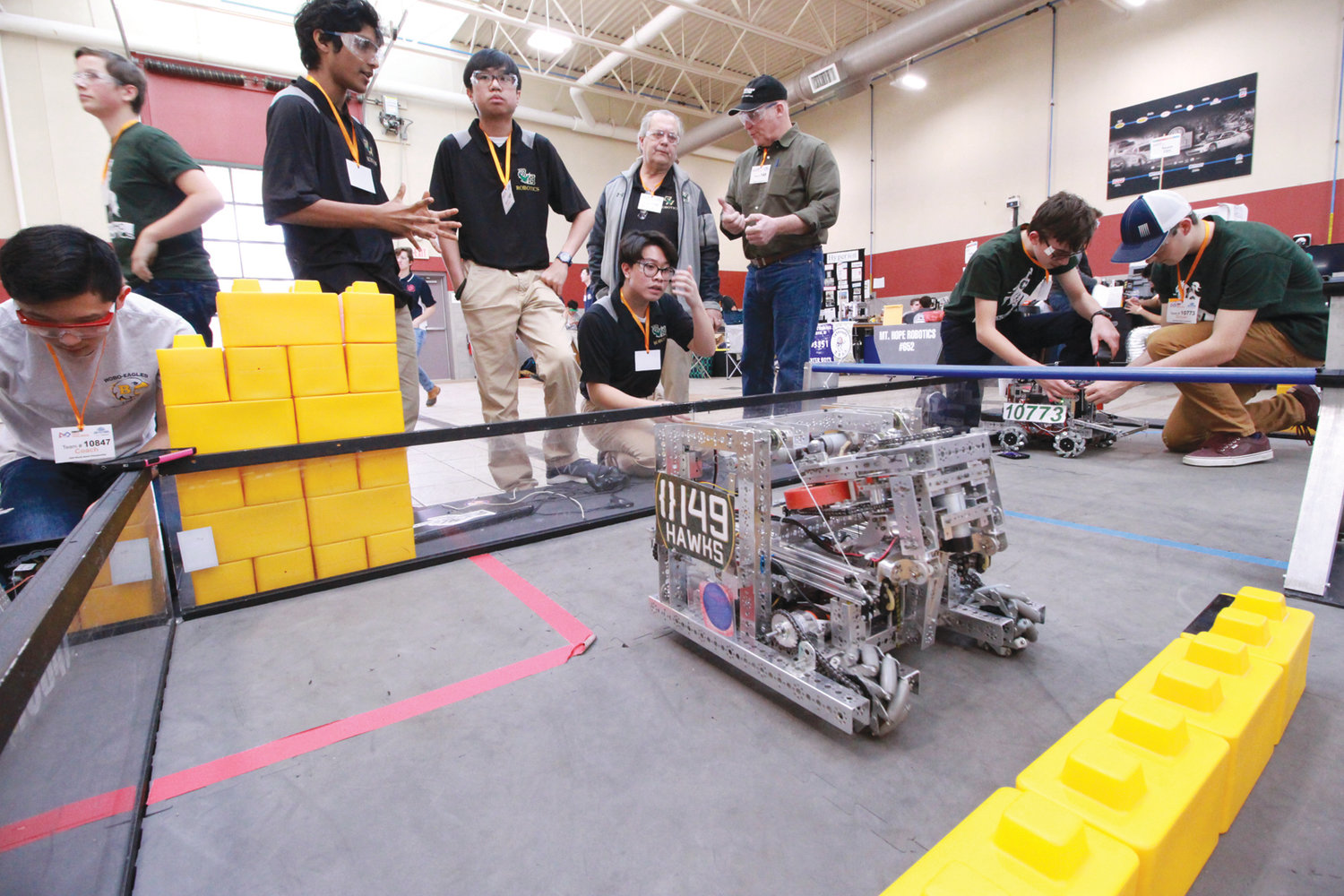 HAWK POWER: The Bishop Hendricken Hawk team looks on as their robot makes an autonomous run in the practice ring.