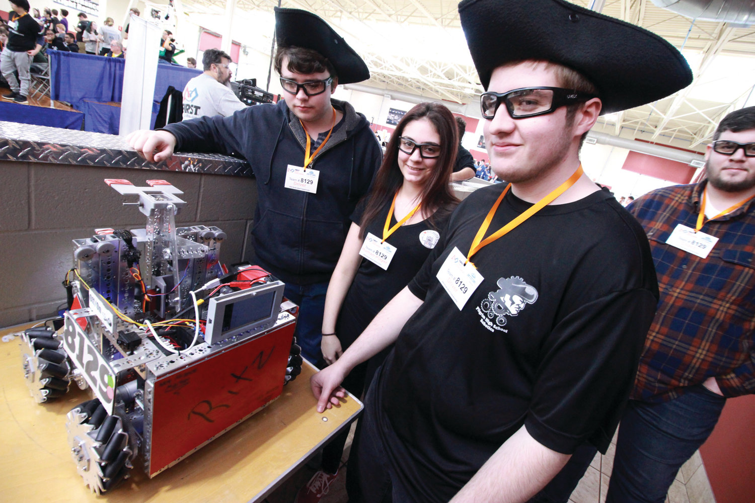 ONE OF FEW: Not many girls were members of the 28 teams competing Saturday. Pilgrim's Jordan Pennacchia was an exception. Throughout construction of the robot, a process that started in the fall, she kept a record of the progress in a notebook that is evaluated as part of the team score. She's pictured with Connor Fisette and Aidan Sanita.