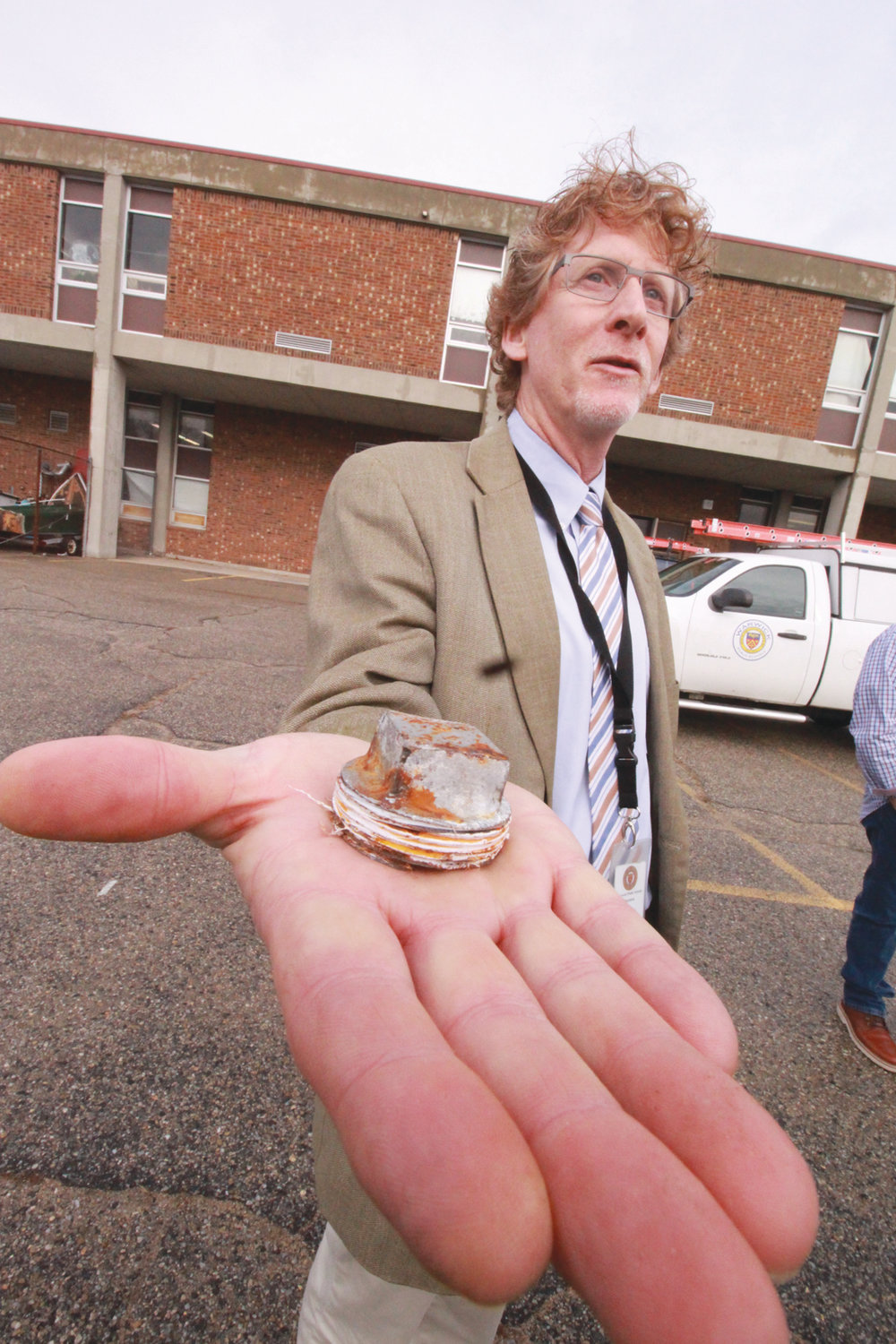 THE CULPRIT: Superintendent Philip Thornton holds the rusted plug that broke off Toll Gate's utility well.