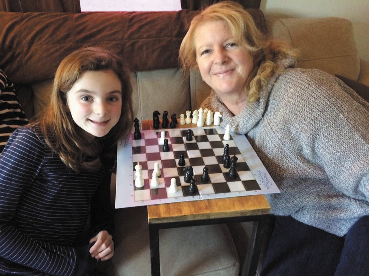 Janice York Torilli, a longtime sales consultant at the Cranston Herald, is seen here with playing chess with one of her favorite people, granddaughter Kelsey.  To get your business back on the map, call Jan today at 401-732-3100.