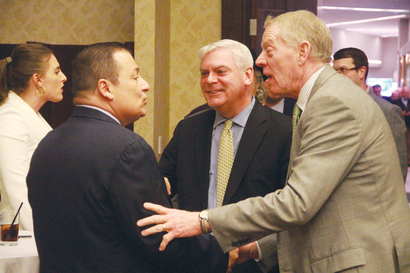 AMONG FRIENDS: Rep. K. Joseph Shekarchi greets Scott Avedisian, former Warwick mayor and president and CEO of the Rhode Island Public Transit Authority, and Peter Harrington at his fundraiser Tuesday.