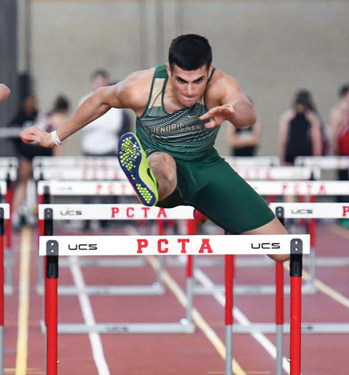 LEAPS AND BOUNDS: Bishop Hendricken's Sean Fagan competes in the hurdles.