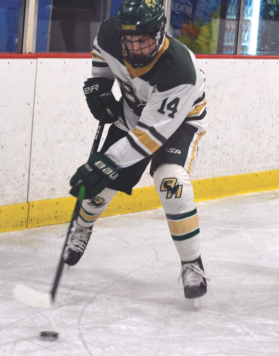 ALONG THE BOARDS: Bishop Hendricken's Matthew Moretti, who scored a pair of goals over the weekend.