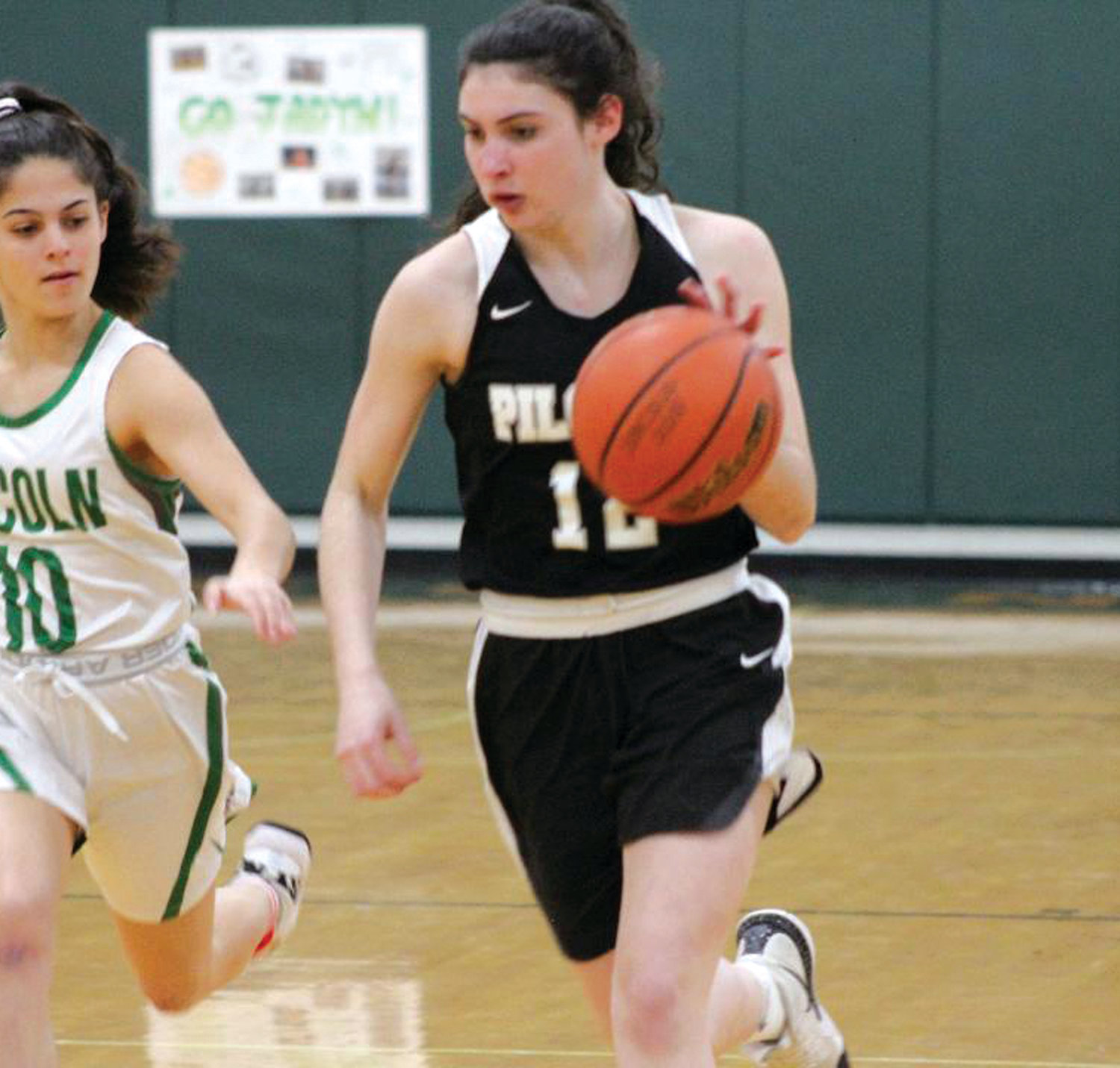 UP THE COURT: Hannah French races up the court against Lincoln School.