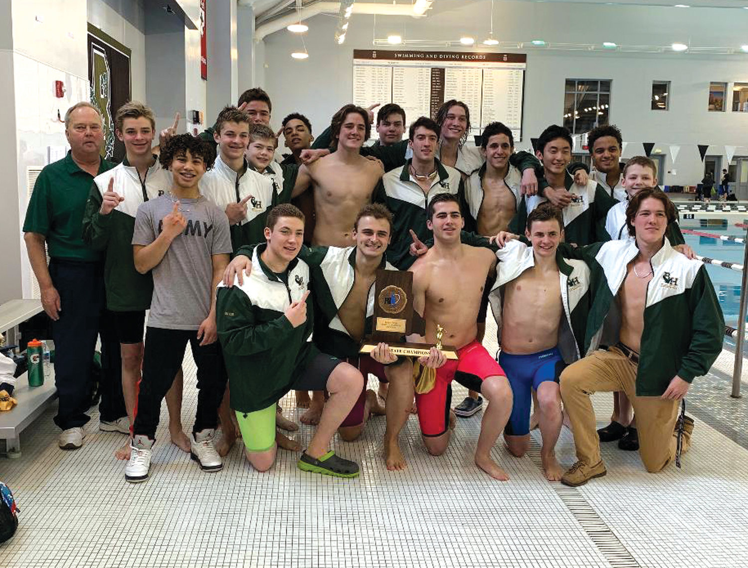 STATE CHAMPS: The Bishop Hendricken swim team after winning the state championship.