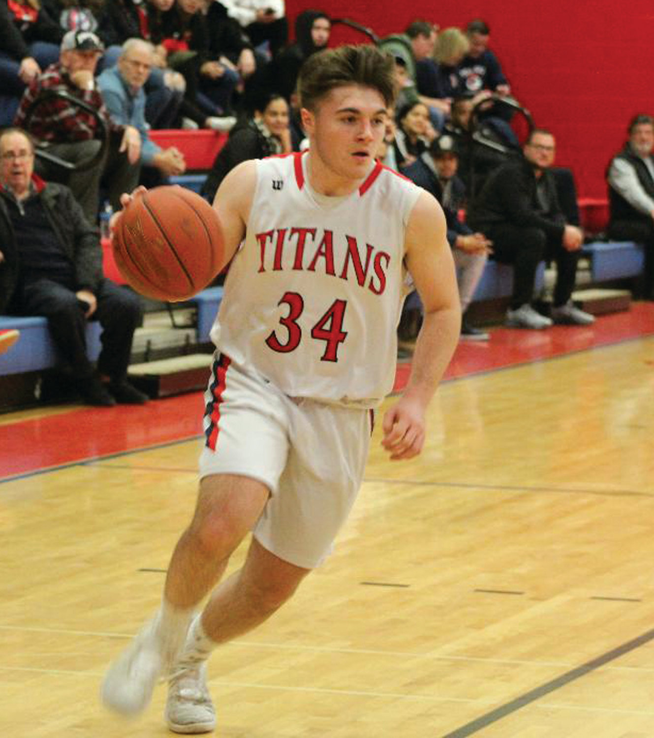 PLAYOFF WIN: Toll Gate's Austin Noon takes the ball up the court against Central Falls in the Division III Prelims last week. Noon scored 15 points in the Titans' 68-55 win over the Warriors. The Titans will now hit the road to take on the Johnston Panthers in the quarterfinals.