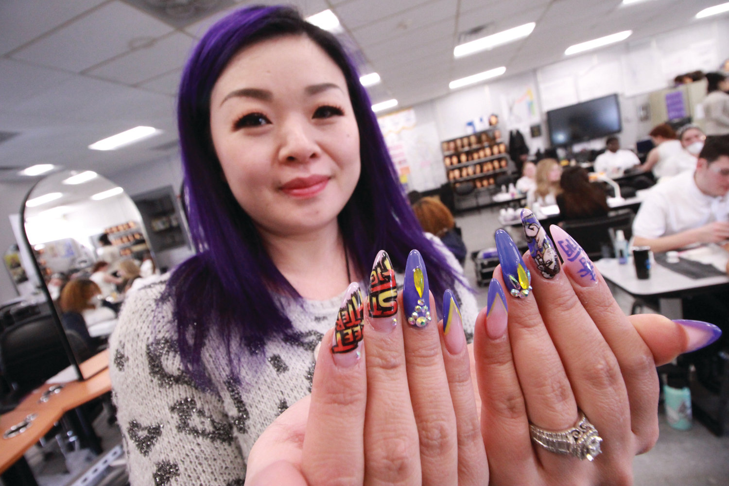A(R)T YOUR FINGERTIPS: Kerry Pez, who owns InternatioNails in Cranston, served as judge for the nail care portion of the competition. As part of the event, students had to do nail art.