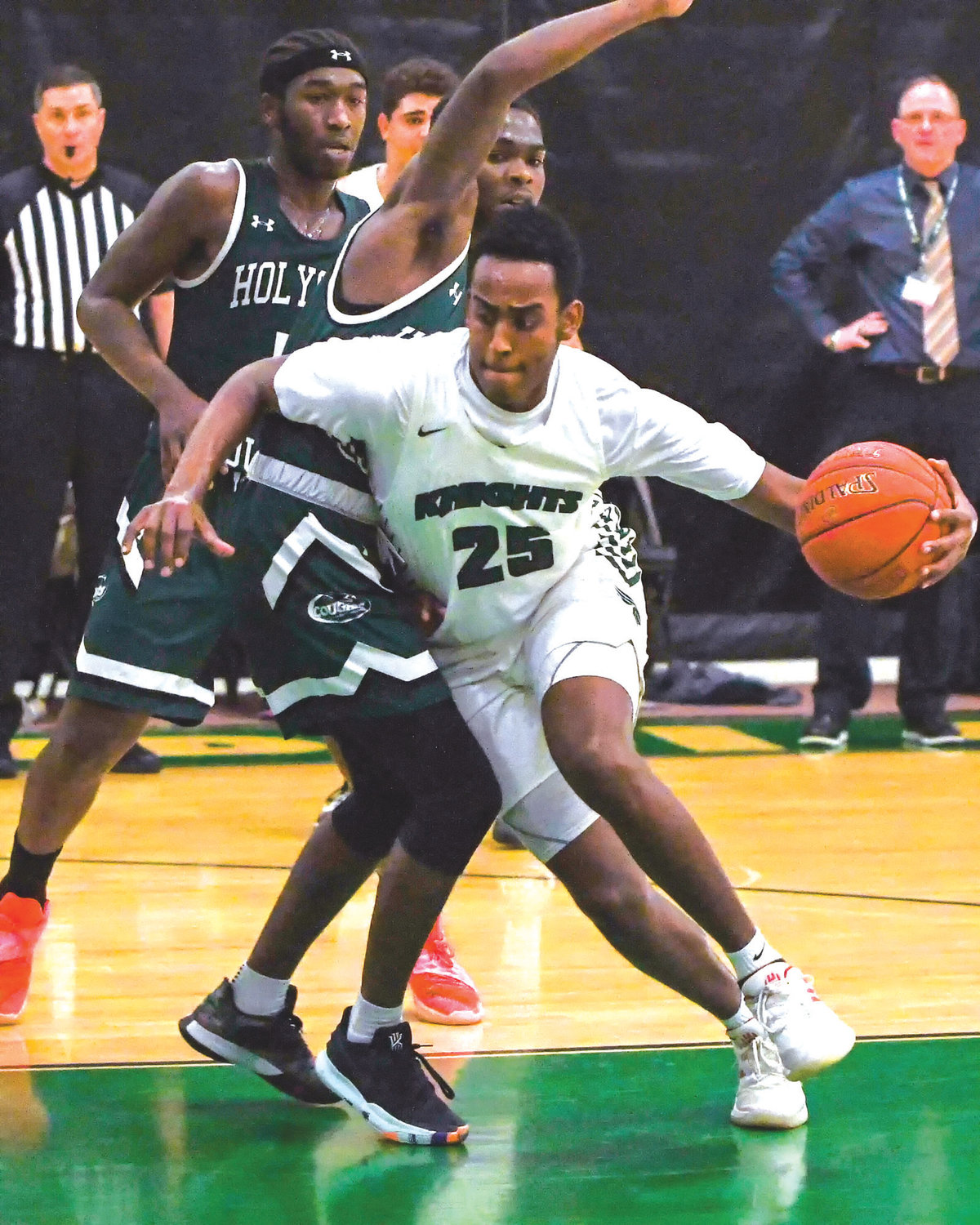 TOURNEY READY: CCRI's Bereket Janat works past a Holyoke defender last week.