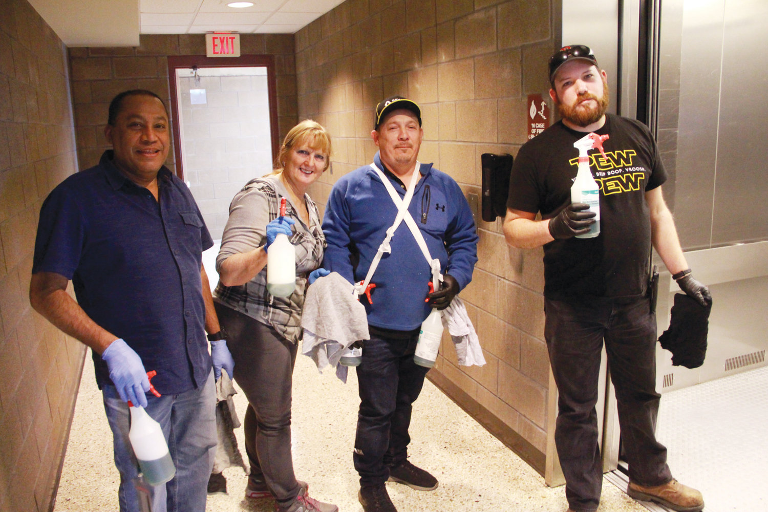 KEEPING IT CLEAN: The custodial crew at the Knight Campus of CCRI made the rounds spraying door handles and surfaces Sunday during the Rhode Island Academic Decathlon.