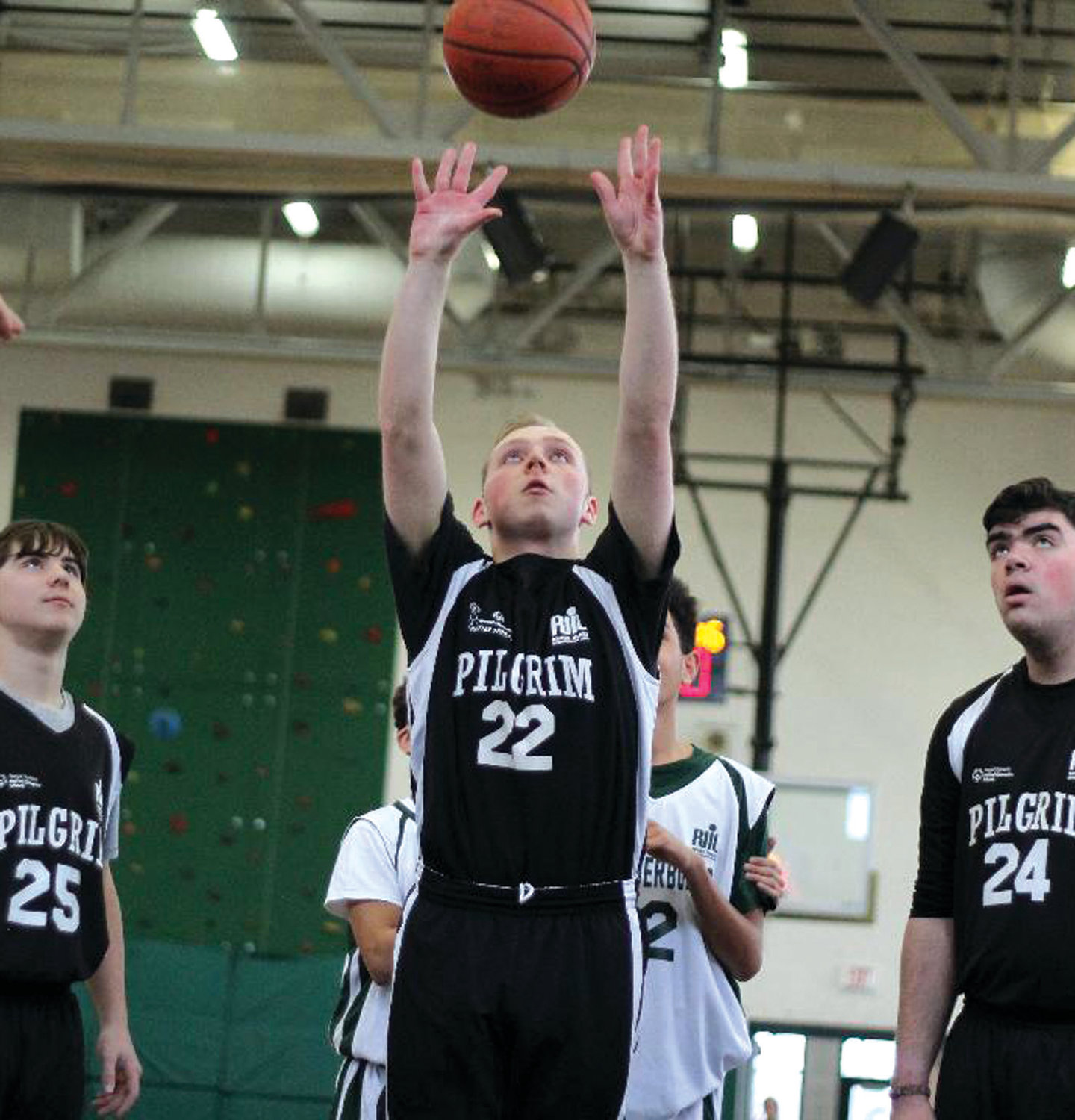 EYES ON THE PRIZE: Pilgrim's John Plunkett puts up a shot last week at Cranston East.