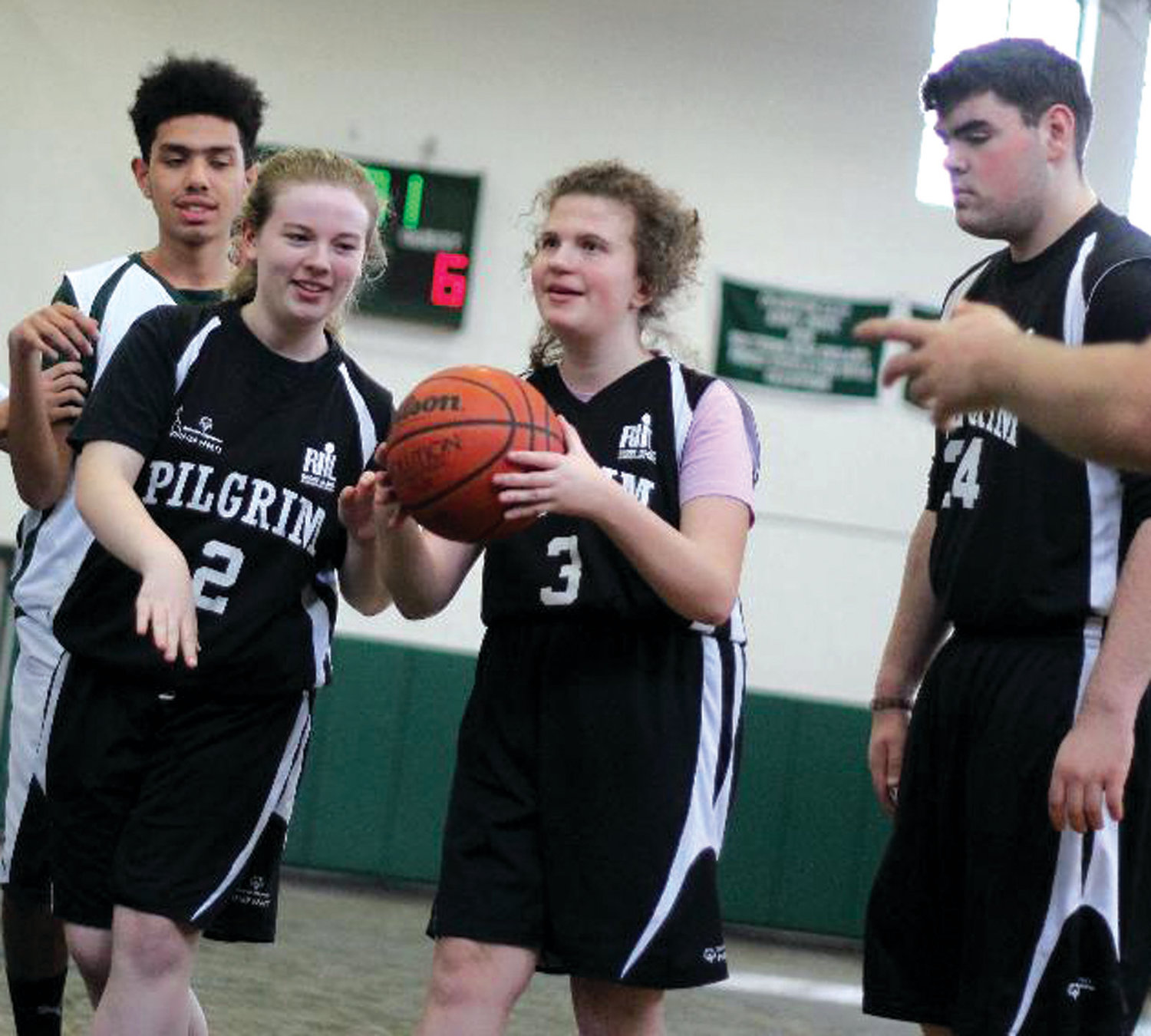 DRIVING: Pilgrim's Olivia Doyle, along with teammates, drives to the basket.