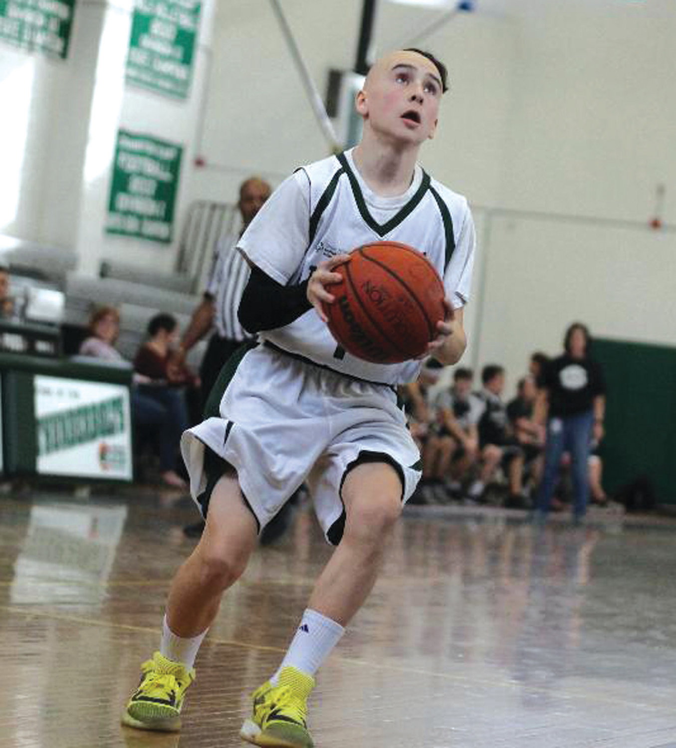 UP THE COURT: Cranston East's Sam Gray.