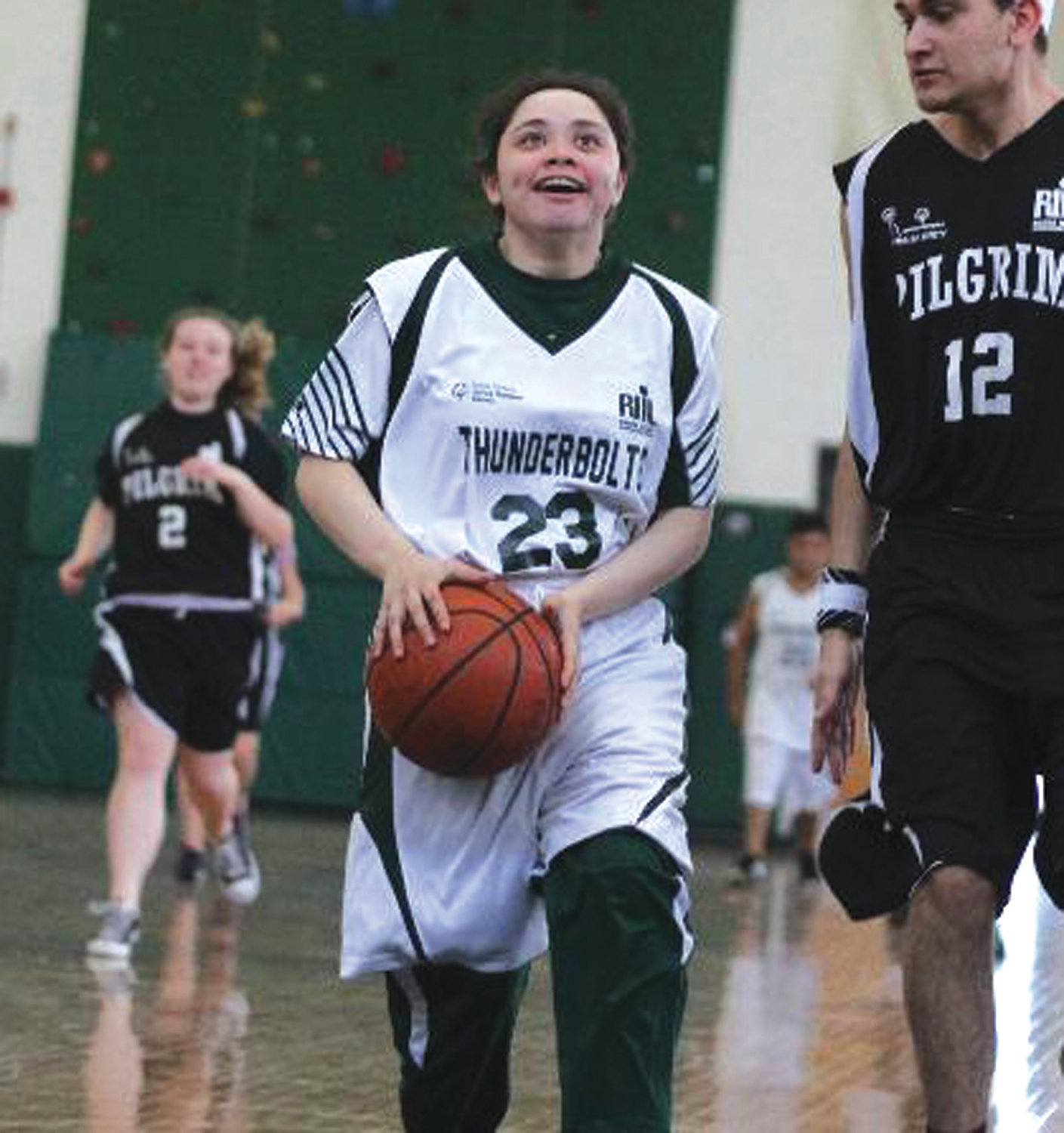 DRIVING: Cranston East's Emily Sanita drives to the hoop last week.