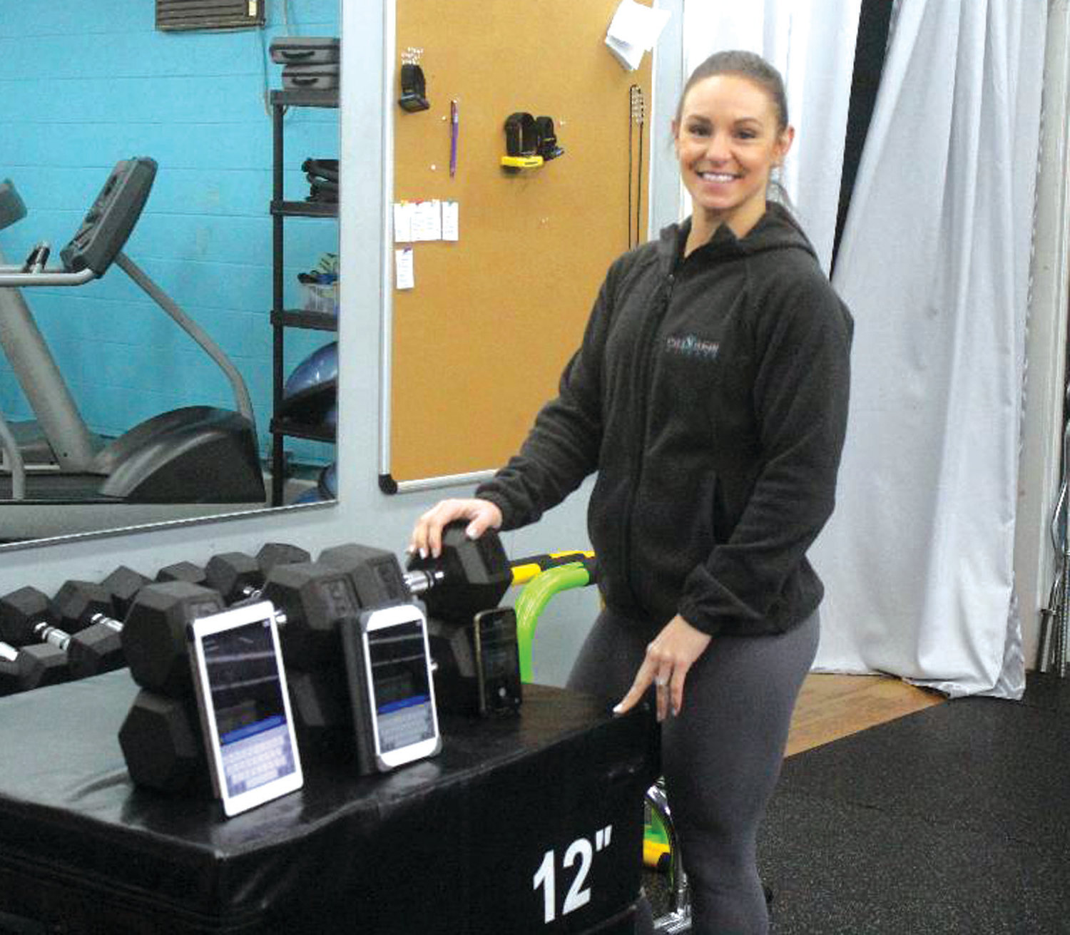 VIRTUAL WORKOUT: Stacie Venagro, owner of Stacie Venagro Fitness in Cranston, shows off the setup she has been using to host online workouts for her clients during the COVID-19 pandemic. (Photos by Alex Sponseller)