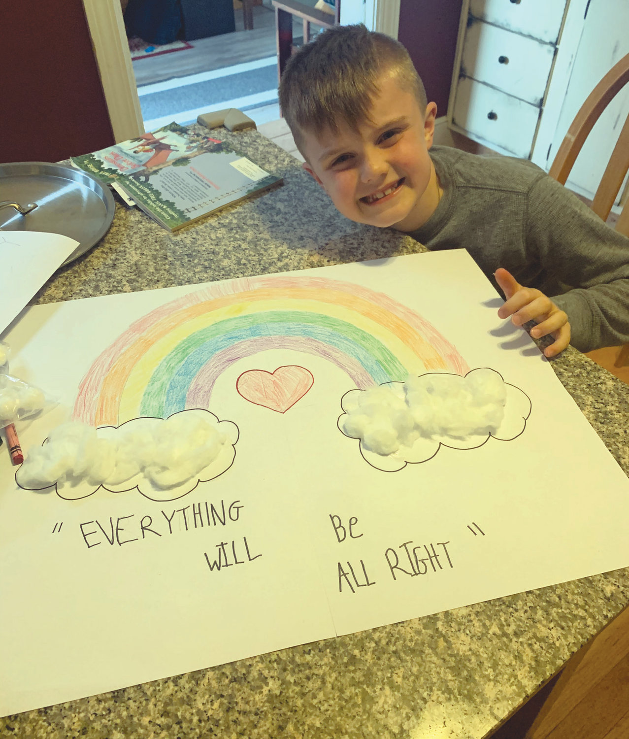MESSAGE OF HOPE: Second grader Jimmy Louth shares an ear to ear grin along with his message of hope.